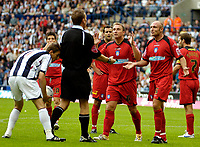 Photo: Ed Godden.<br />West Bromwich Albion v Colchester United. Coca Cola Championship. 19/08/2006. Colchester's Kevin Watson and Wayne Brown disagree with the referees decision to give a penalty.