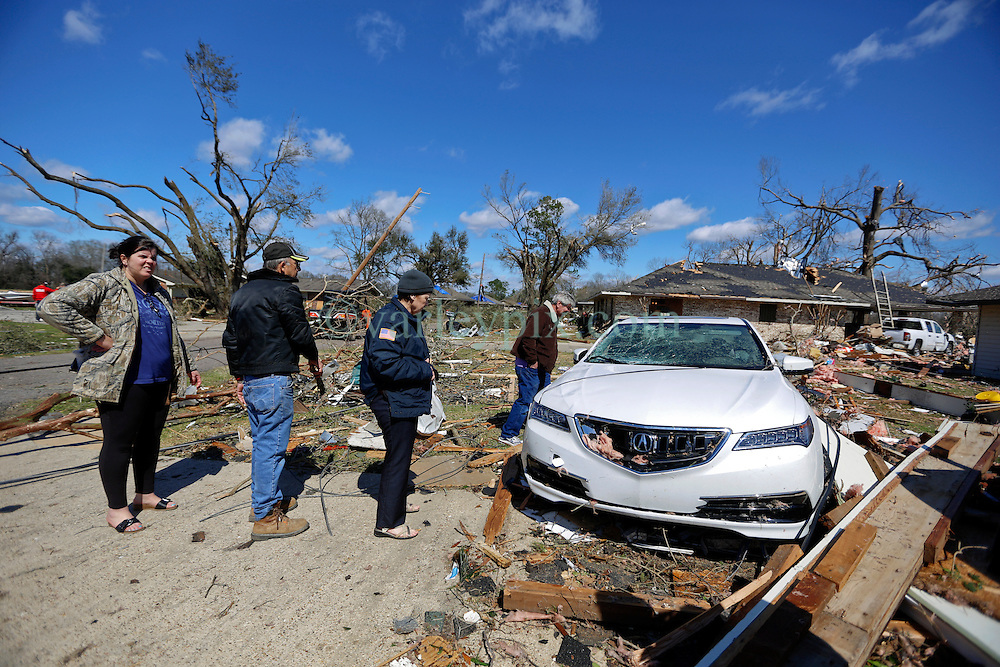 24 February 2016. Schexnaydre St, Convent, Louisiana.<br /> Scenes of devastation following a deadly EF3 tornado touchdown. 2 confirmed dead. Survivors clear debris from their smashed home.<br /> Photo©; Charlie Varley/varleypix.com