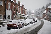 Street scene in Moseley during heavy snow fall on Sunday 10th December 2017 in Birmingham, United Kingdom. Deep snow arrived in much of the UK, closing roads and making driving treacherous, while many people simply enjoyed the weather.