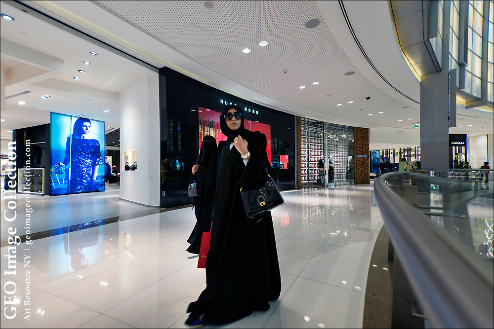 Arab women shop in the Dubai Mall, one of the largest shopping mall in the world with 1,200 retail outlets, two anchor department stores, and more than 200 food and beverage outlets. The mall is located next to the world's tallest building, the Burj Khalifa.