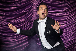Image ©Licensed to i-Images Picture Agency. 29/06/2014. Manchester , UK . Robbie Williams Live Manchester. Robbie Williams performs at the Phones4U Arena in Manchester this evening (Sunday 29th June 2014) . Picture by i-Images