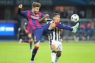 Barcelona Gerard Piqué and Carlos Tévez of Juventus battle during the Champions League Final between Juventus FC and FC Barcelona at the Olympiastadion, Berlin, Germany on 6 June 2015. Photo by Phil Duncan.