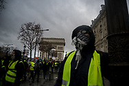 The Arc de Thriomphe. More than 125000 gathered in Paris for the Gilets Jaune (Yellow vest) protest. Soon the protest turned violent an protesters clashed with the police, tear gas and flash bombs were fired, many injured and arrested by the police. Paris December 6th 2018. Federico Scoppa