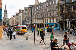 Edinburgh, Scotland, UK. 6th August  2021.  Images from the Royal Mile in Edinburgh Old Town on the opening day of the Edinburgh Fringe Festival 2021.  The festival looks very different from two years ago . Very few street performance spaces are permitted and far fewer tourists are evident. Also a high police visibility, there are more police officers than performers on the street, is in marked contrast to previous years. Pic; Area on royal Mile where street performers normally perform is now empty and used to park Police command vehicle.  Iain Masterton/Alamy Live news.