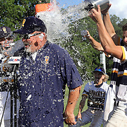 Whiteford players pour water on coach Terry Pant as he speaks to BCSN after their 9-2 victory in the MHSAA Division 4 regional semifinal baseball game between Whiteford and Plymouth Christian at Whiteford High School in Ottawa Lake, Mich., on Wednesday, June 9, 2021. THE BLADE/KURT STEISS