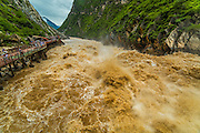 DIQING, CHINA - JULY 15: <br /> <br /> Flooded Jinsha River Runs Through Tiger Leaping Gorge In Diqing<br /> <br /> Aerial view of tourists watching the flooded Jinsha River at the Tiger Leaping Gorge on July 15, 2016 in Diqing Tibetan Autonomous Prefecture, Yunnan Province of China. Heavy rainfall in Southwest China rose the water level of Jinsha River which attracted many tourists coming to the Tiger Leaping Gorge in Diqing. <br /> ©Exclusivepix Media