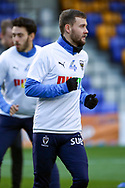 AFC Wimbledon attacker Shane McLoughlin (19) warming up prior to kick off during the EFL Sky Bet League 1 match between AFC Wimbledon and Bristol Rovers at Plough Lane, London, United Kingdom on 5 December 2020.