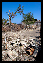 30th Sept, 2005. Hurricane Katrina aftermath, New Orleans, Louisiana. Lower 9th ward. The remnants of the lives of ordinary folks, now covered in mud as the flood waters remain. Toilets are all that remain of the building that once surrounded them but was swept away in the floods.