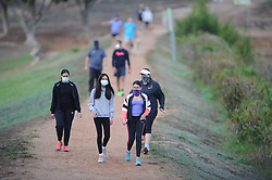 South Africa - Cape Town - 7 May 2020 - Day 42 of the National Lockdown. People wear  face masks during a morning walk at Sonstraal Dam in Durbanville duringLevel 4 of the National Lockdown. Level 4 allows for people to leave their homes for exercisebetween 06h00 and 09h00. South Africans are not allowed to be without a facemask in a public space during the National Lockdown. South Africans are in Level 4 of the National Lockdown to curb the spread of the coronavirus. Picture: Henk Kruger/African News Agency (ANA)