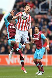29th April 2017 - Premier League - Stoke City v West Ham United - Peter Crouch of Stoke battles with Edimilson Fernandes of West Ham - Photo: Simon Stacpoole / Offside.