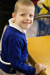 Child with cerebral palsy smiling,