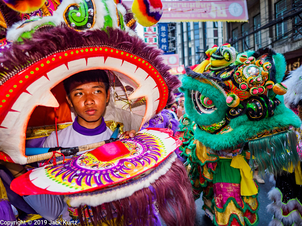 05 FEBRUARY 2019 - BANGKOK, THAILAND: Chinese New Year Lion dancers on Yaowarat Road in Bangkok. Chinese New Year celebrations in Bangkok started on February 4, 2019, although the city's official celebration is February 5 - 6. The coming year will be the Year of the Pig in the Chinese zodiac. About 14% of Thais are of Chinese ancestry and Lunar New Year, also called Chinese New Year or Tet is widely celebrated in Chinese communities in Thailand.      PHOTO BY JACK KURTZ
