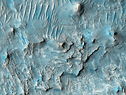 Ius Chasma is one of several canyons that make up Valles Marineris, the largest canyon system in the Solar System.