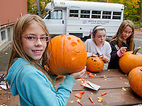 Leah, Allie and Eclipse carve pumpkins to be added to the Pumpkin Fest tally at the Laconia Boys and Girls Club on Tuesday afternoon.  (Karen Bobotas/for the Laconia Daily Sun)