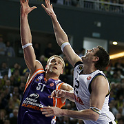 Fenerbahce Ulker's Darjus LAVRINOVIC (R) and Power Electronics Valencia's Robertas JAVTOKAS (L) during their Euroleague Basketball Top 16 Game 2 match Fenerbahce Ulker between Power Electronics Valencia at Sinan Erdem Arena in Istanbul, Turkey, Thursday, January 27, 2011. Photo by TURKPIX