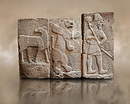 Late Hittite (Aramaean)  Basalt relief sculptures  from 9th Cent B.C, excavated from the west side of the citadel gate of Sam'al (Hittite: Yadiya) located at Zincirli Höyük in the Anti-Taurus Mountains of modern Turkey's Gaziantep Province. Left Deer Buck, Inv no 7712, Middle Winged Lion inv no. 7706, Left Male with Axe Inv No. 7727. Istanbul Archaeological Museum. .<br />  <br /> If you prefer to buy from our ALAMY STOCK LIBRARY page at https://www.alamy.com/portfolio/paul-williams-funkystock/hittite-art-antiquities.html  - Type -   Samal   - into the LOWER SEARCH WITHIN GALLERY box. Refine search by adding background colour, place, museum etc<br /> <br /> Visit our HITTITE PHOTO COLLECTIONS for more photos to download or buy as wall art prints https://funkystock.photoshelter.com/gallery-collection/The-Hittites-Art-Artefacts-Antiquities-Historic-Sites-Pictures-Images-of/C0000NUBSMhSc3Oo
