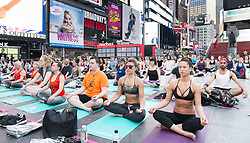June 21, 2017 - New York, NY, U.S - Large yoga session in Times Square in honor of the solstice, in New York City, New York on June 21, 2017. (Credit Image: © Michael Brochstein via ZUMA Wire)
