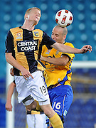 GOLD COAST, AUSTRALIA - SEPTEMBER 19:  Matt Simon of the Mariners contests the ball with Kristian Rees of the Gold Coast during the round seven A-League match between Gold Coast United and the Central Coast Mariners at Skilled Park on September 19, 2010 in Gold Coast, Australia.  (Photo by Matt Roberts/Getty Images)