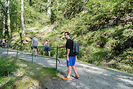 Nader Turkmani waiting for friends as they climb the Fløren mountain surrounding Bergen, Nader's new home after receiving political asylum in the country in early 2016.