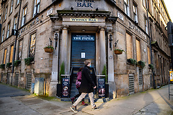 Glasgow, Scotland, UK. 25 November 2020. Glasgow city centre  very quiet during severe level 4 lockdown imposed by the Scottish Government.  Non essential businesses , bars, restaurants and shops are closed. Pictured;  The Piper Bar is closed and boarded up. Credit.  Iain Masterton