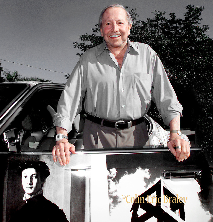 "American pop culture artist Robert Rauschenberg poses next to one of his ""Beamer"" collages at an art gallery in Naples, Florida in this 2002 file photo. The 82-year-old died Monday, May 12, 2008, of heart failure according to Jennifer Joy, his representative at PaceWildenstein gallery in New York. Rauschenberg's incorporation of everyday items, both common place and the odd in his artwork earned him the reputation as a pioneering pop artist, gaining fame in the 1950's. Photo by Colin Braley."