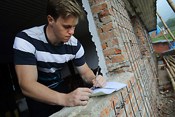 Bryce Harris, an AVID works with National Society for Earthquake Technology Nepal (NSET), he can be seen inspecting the rehabilitation of a school building, to make it more earthquake proof, Kathmandu, Nepal.