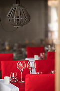 Restaurant with tables and red chairs prepared for guests, Bonifacio, Corsica, France