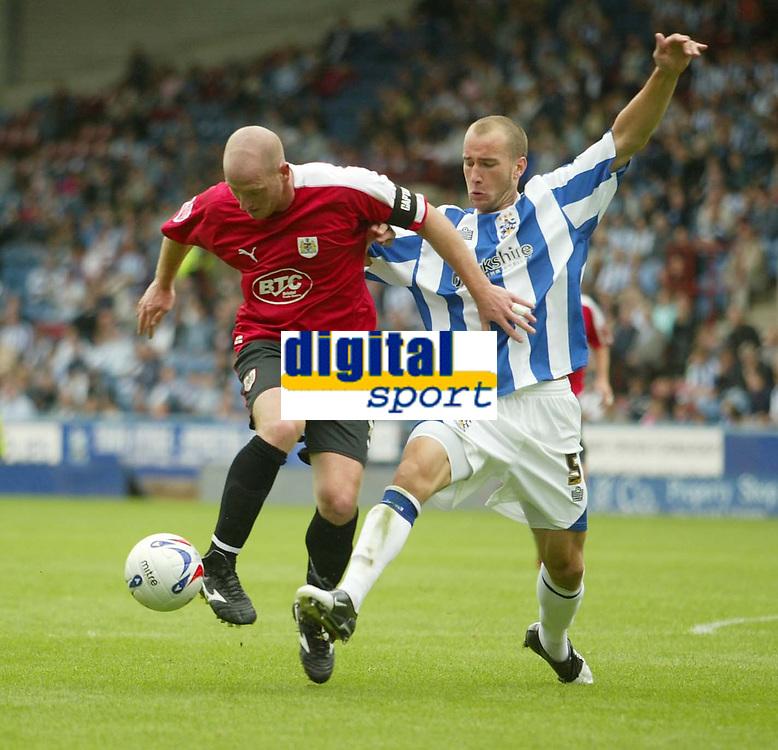 Photo: Aidan Ellis.<br /> Huddersfield Town v Bristol City. Coca Cola League 1. 12/08/2006.<br /> Bristol's Steve Brooker holds off the challenge from huddersfield's David Mirfin
