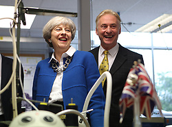 Prime Minister Theresa May with local candidate Kevin Horkin on a General Election campaign visit to Simon Jersey, a business uniform supplier in Accrington, Lancashire.