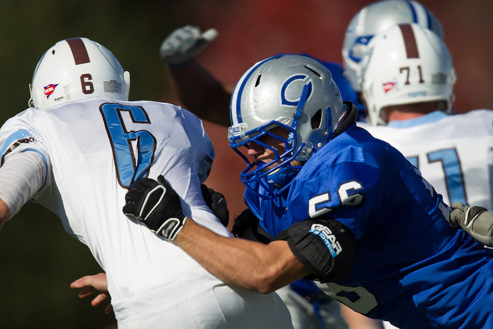 Caleb Harris, of Colby College, pressures the quarterback during a NCAA Division III football game on November 2, 2013 in Waterville, ME. (Dustin Satloff/Colby College Athletics)