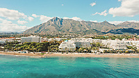 Aerial view of beautiful and colourful coast and famous landmark La Concha in Marbella, Spain