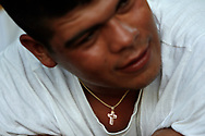 Migrant worker, Santaigo Lara talks with friends before playing soccer on his day off. Lara has worked at the farm for three years, he has a wife and two children back home in Nayarit, Mexico.