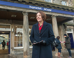 Scottish Labour launch a leaflet promoting their rail fare freeze policy, as well as a further breakdown of the impact of a rail fare freeze.  The leaflet is in the style of a rail ticket.  <br /> <br /> Pictured: Scottish Labour leader Kezia Dugdale outside Haymarket train station in Edinburgh.