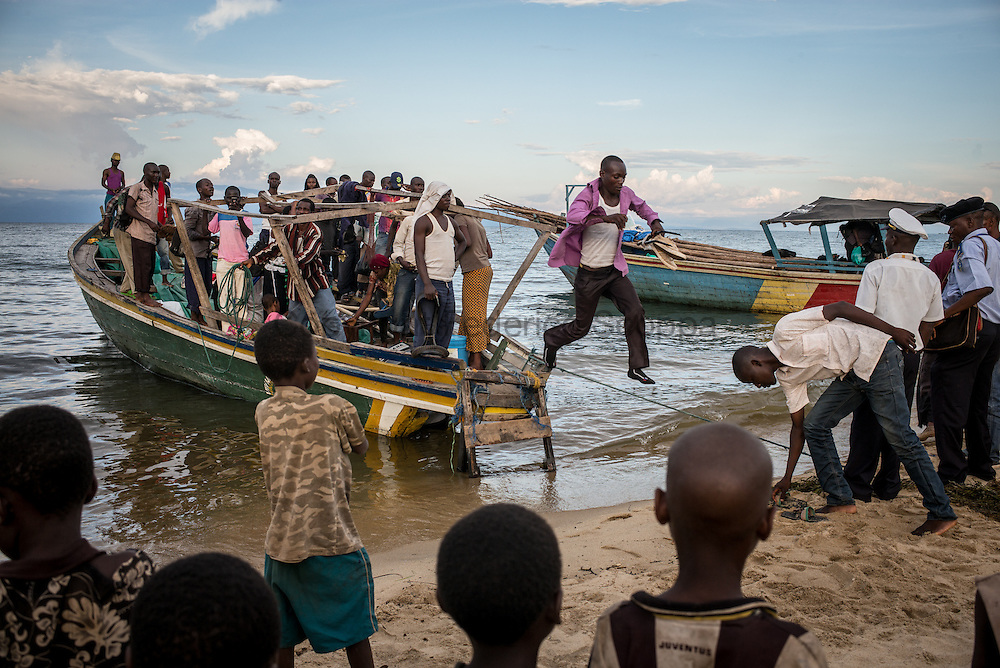 DRC / Burundi Refugees / On this picture taken on May 12, a boat is seen landing on the DRC coast of lake Tanganyika in Mboko in DRC's south Kivu. Among the passengers more 50 Burundian refugees were onboard.<br /> More than 9000 Burundians refugees have crossed into the DRC over the past few weeks. The new<br /> arrivals are being hosted by local families, but the growing numbers are straining<br /> available support.  Work is ongoing to identify a site<br /> where all the refugees can be moved, and from where they can have access to<br /> facilities such as schools, health centers and with proper security. / UNHCR / F.Scoppa / May 2015
