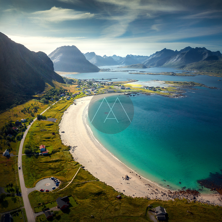 Aerial view of Ramberg beach, Flakstad, Lofoten, Nordland, Norway with the mountains, white sand and turquoise water