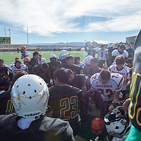 Skyhawks and Mavericks players meet at the center of the field for a group prayer on Saturday in Newcomb. Newcomb defeated Lordsburg 56-20.