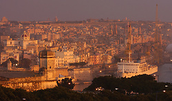 A cruise ship is docked at the Port of Malta in Valletta.