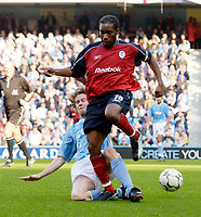 Photo. Jed Wee.<br /> Manchester City v Bolton Wanderers, FA Barclaycard Premiership, City of Manchester Stadium, Manchester. 18/10/03.<br /> Bolton's Jay Jay Okocha (R) is tackled by Manchester City's Steve McManaman.