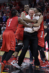 22 February 2017:  Paris Lee, Mikyle McIntosh, and Tony Wills roust Dan Muller as he is recognized for his 100th win as the Redbirds head coach during a College MVC (Missouri Valley conference) mens basketball game between the Southern Illinois Salukis and Illinois State Redbirds in  Redbird Arena, Normal IL