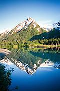 Alaska. Chugach National Forest. Explorer Glacier and Chugach Mountains, reflection in lake.