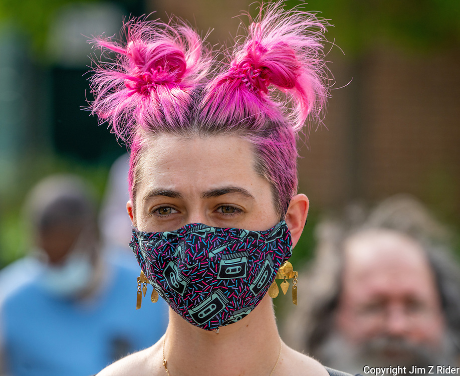 A young woman listens to speeches during a MOVE protest on the campus of the University of Pennsylvania (Penn).