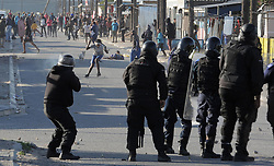 South Africa - Cape Town - 28 June 2020 - Police fire rubber bullets at protestors as a truck was Set alight on Wimbledon Road Blackheath by protestors from the Happy Valley township. Law Enforcement, SAPS had their hands full when hundreds of protestors burnt tyres and threw stones in Happy Valley. Picture: Brendan Magaar/African News Agency(ANA)