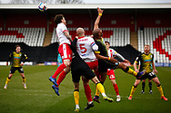 Scott Cuthbert of Stevenage goes into header the ball during the EFL Sky Bet League 2 match between Stevenage and Barrow at the Lamex Stadium, Stevenage, England on 27 March 2021.
