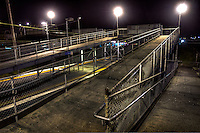 Railway Stations at night. About 9pm,  Jacana railway station, the footbridges are reminiscent of cattle ramps. Pic By Craig Sillitoe CSZ/The Sunday Age The Age iPad App.5/8/2011 This photograph can be used for non commercial uses with attribution. Credit: Craig Sillitoe Photography / http://www.csillitoe.com<br /> <br /> It is protected under the Creative Commons Attribution-NonCommercial-ShareAlike 4.0 International License. To view a copy of this license, visit http://creativecommons.org/licenses/by-nc-sa/4.0/.