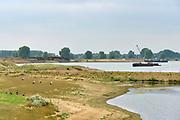 Nederland, Megen, 16-7-2019Langs de Maas tussen Grave en Lith moeten nog belangrijke aanpassingen gedaan worden door Rijkswaterstaat om de rivier klaar te maken voor de toekomst . Hierdoor ontstaan nieuwe recreatiegebieden en natuurgebieden . recreatieplas, recreatie . Het Deltaplan is nog in uitvoering en heet hier de meanderende maas .  Foto: Flip Franssen