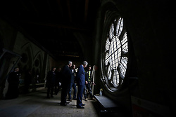 The Prince of Wales is shown works taking place beside a window, flanked by the Dean of Westminster John Hall (fourth right) during his visit to the The Queen's Diamond Jubilee Galleries at Westminster Abbey in London.