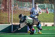 Brighton's goalkeeper Dave Bockett-Pugh saves a Southgate penalty corner. Southgate v Brighton & Hove, Trent Park, Southgate, UK on 01 December 2013. Photo: Simon Parker