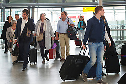 © licensed to London News Pictures. London, UK 17/04/2014. People waiting for their flights at Heathrow Airport terminal 5 in London on April 17, 2014 ahead of Easter holiday. Photo credit: Tolga Akmen/LNP