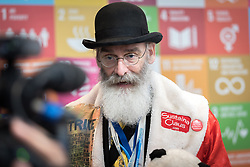 2 December 2019, Madrid, Spain: Sustaina Claus from Conscience Land is interviewed on television, as he attends day one of COP25 in Madrid. Alongside political leaders and negotiators, COP25 is attended by a broad range of activists trying to promote ambitious action to address climate change.