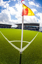 An upright image with sunlight caught in the corner flag,with the main stand behind. The Falkirk Stadium, with the new pitch work for the Scottish Championship game v Morton. The woven GreenFields MX synthetic turf and the surface has been specifically designed for football with 50mm tufts compared with the longer 65mm which has been used for mixed football and rugby uses.  It is fully FFA two star compliant and conforms to rules laid out by the SPL and SFL.<br /> ©Michael Schofield.